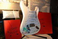 Scarfe On The Wall and Strat guitar signed by Pink Floyd