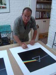 Aubrey 'Po' Powell signing Pink Floyd's The Dark Side of the Moon print
